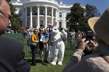 Guests take pictures with the Easter Bunny during the annual Easter Egg Roll on the South Lawn of the White House in Washington
