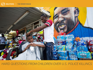 The Wider Image: Hard questions from children over U.S. police killings