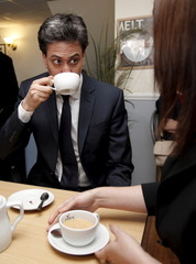 Britain's opposition Labour Party leader Miliband drinks a cup of tea at Cheswicks Coffee Shop during a campaign event in north Birmingham