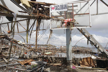Debris hang on basketball post near thousands of houses damaged after super Typhoon Haiyan battered Tacloban city