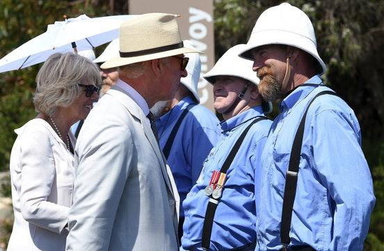 Britain's Prince Charles and his wife, Camilla the Duchess of Cornwall walk through an honour guard wearing pith helmets as they visit the National Anzac Centre in Albany, Western Australia