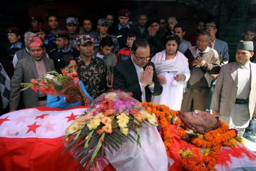Nepal's Prime Minister Jhala Nath Khanal pays his final respects to the body of Nepal's former prime minister and founder of the Nepali Congress Krishna Prasad Bhattarai near Kathmandu