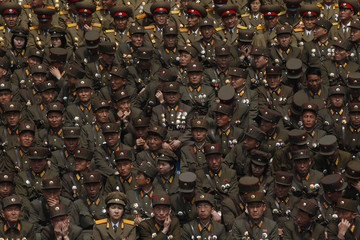 A soldier wearing military medals joins thousands of soldiers taking part in a ceremony in Pyongyang