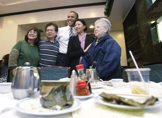 U.S. President Barack Obama poses for a picture at a Chinese restaurant in San Francisco