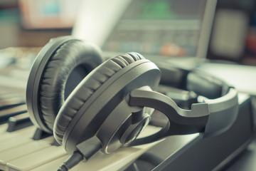 Studio Music headphone on music keyboard in a Home music studio DAW desktop
