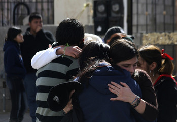 Friends and family mourn the death of a 19-year old student, who was killed at a high school birthday party, in Ciudad Juarez