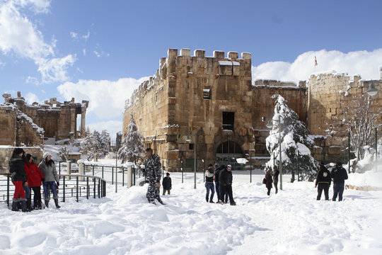 Residents enjoy snow near ruins of Roman Temples of Bacchus at historical ruins of Baalbek in eastern Lebanon