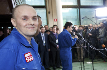 Mars500 experiment crew member Alexey Sitev of Russia looks on after leaving the mock spaceship in Moscow