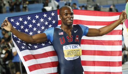 Merritt holds his national flag after placing second in the men's 400 metres final at the IAAF World Championships in Daegu