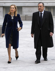 Spain's Development Minister Pastor arrives with Real Madrid President Perez for the swearing-in ceremony of new Madrid Mayor Botella at Madrid's Town Hall