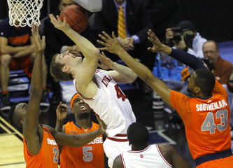 Indiana Hoosiers Zeller fights for the ball with Syracuse Orange Christmas during the first half in their East Regional NCAA men's basketball game in Washington