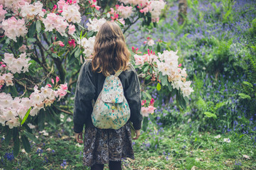 Woman looking at rhododendron