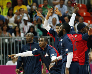 Players of the U.S.  react from the bench during their men's preliminary round Group A basketball match against Argentina at the Basketball Arena during the London 2012 Olympic Games