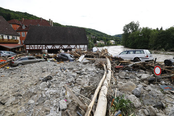Cars lie amongst debris following floods in the town of Braunsbach in Baden-Wuerttemberg