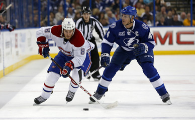 Canadiens' Prust avoids the check of Lightning's Lecavalier during their NHL hockey game in Tampa