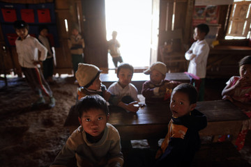 Children gather at a school of the village of Tar-Pu, in the mountains of Shan State