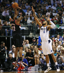 Trail Blazers' Aldridge shoots over Mavericks' Chandler during their NBA Western Conference playoff game in Dallas