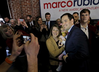 U.S. Republican presidential candidate Marco Rubio takes a picture with a supporter during a campaign event at Swamp Rabbit Crossfit in Greenville