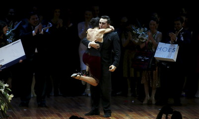 Tango couple Saavedra and Aragon embrace after winning the Tango World Championship in Salon style in Buenos Aires