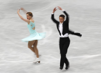 Finland's Henna Lindholm and Ossi Kanervo compete during the ice dance short dance program at the ISU World Figure Skating Championships in Saitama