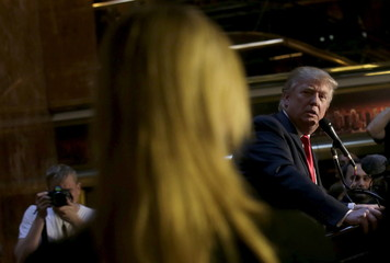 """Republican presidential candidate Donald Trump looks over at his daughter Ivanka at news conference to promote his new book """"Crippled America"""" in New York"""