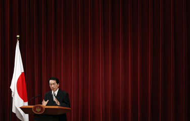 New Japanese leader Naoto Kan speaks to journalists during a news conference  in Tokyo