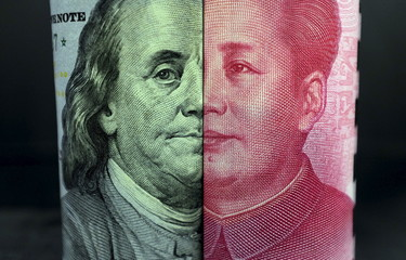 U.S. 100-dollar banknote with a portrait of Benjamin Franklin and a Chinese 100-yuan banknote with a portrait of late Chinese Chairman Mao Zedong are seen in the picture illustration in Beijing