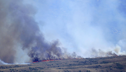 The Wood Hollow Fire burns along a ridge line as it heads north into Utah County
