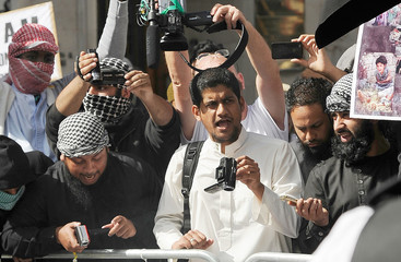 A file picture shows a man identified by local media as Siddharta Dhar as he takes part in a demonstration outside the U.S. embassy in central London