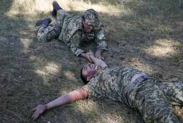Priests of the Ukrainian Orthodox Church of Kiev Patriarchate take part in tactical medical exercises in Kiev