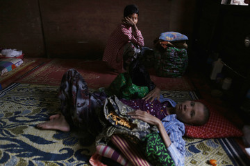 Patients rest inside a HIV/AIDS hospice in the suburbs of Yangon