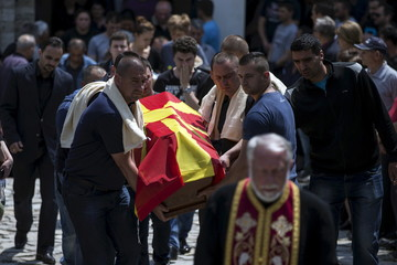 Relatives of killed policeman Samoilovski carry his coffin covered in Macedonian flag before his funeral in the town of Tetovo