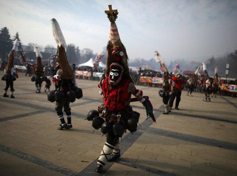 Dancers wearing masks take part in the International Festival of Masquerade Games 'Surva' in Pernik