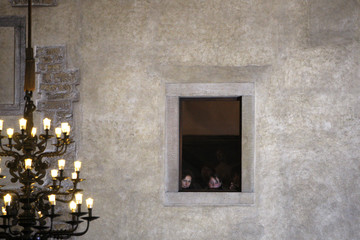 People peer through a window during a memorial service for late former Czech President Havel inside Prague Castle