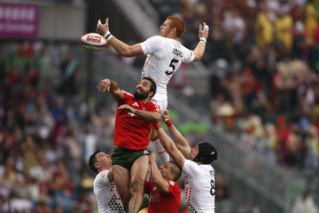 England's Rodwell and Portugal's Leal fight for the ball during the second day of the three-day Hong Kong Sevens rugby tournament
