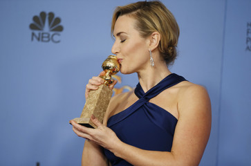 "Actress Kate Winslet poses with her award for Best Performance by an Actress in a Supporting Role in any Motion Picture for her role in ""Steve Jobs"" at the 73rd Golden Globe Awards in Beverly Hills"