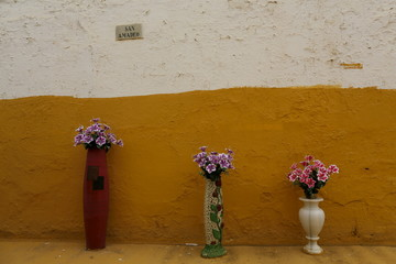 Vases of flowers are displayed as part of decoration of a tomb during All Saints Day at the cemetery of San Fernando in the Andalusian capital of Seville