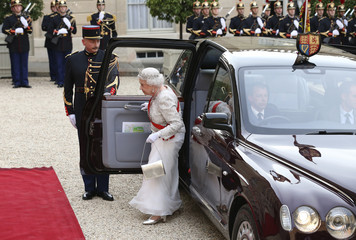 Britain's Queen Elizabeth arrives to attend a State Dinner at the Elysee Palace in Paris