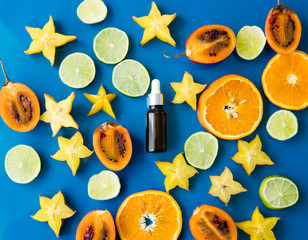cut exotic fruits and serum