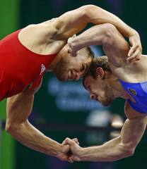 Eisele of Germany fights with Pyshkov of Ukraine during their bronze medal fight of the Men's 75Kg greco-roman wrestling at the 1st European Games in Baku