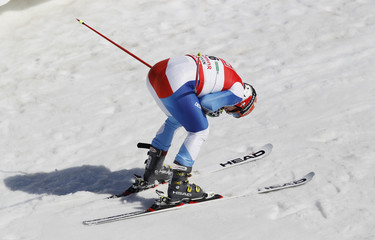 Cuche of Switzerland reacts in the finish area during the men's Giant Slalom race at the alpine ski World Cup finals in Schladming