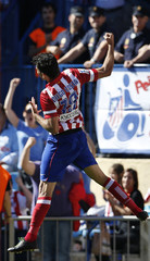 Atletico Madrid's Diego Costa celebrates his second goal against Celta Vigo during their Spanish first division soccer match at Vicente Calderon stadium in Madrid