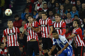 Athletic Bilbao's players jump to block the ball during a free kick by Porto in their Champions League Group H soccer match at San Mames stadium in Bilbao