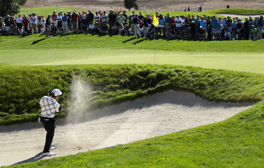 Louis Oosthuizen of South Africa hits a shot from a green side bunker at the eighth hole during the third round of a PGA Tour golf tournament in San Martin, California