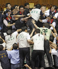 Opposition DPP legislators scuffle with ruling KMT legislators at the Legislative Yuan In Taiwan