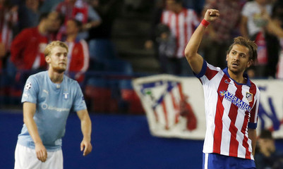Atletico Madrid's Cerci celebrates after scoring a goal against Malmoduring their Champions League soccer match in Madrid