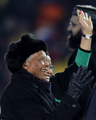 Former South African President Mandela waves to crowd at Soccer City stadium during the closing ceremony for the 2010 World Cup in Johannesburg