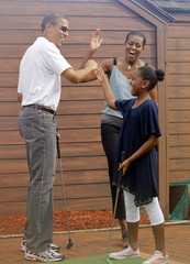 U.S. President Obama and his family play put put golf in Panama City Beach