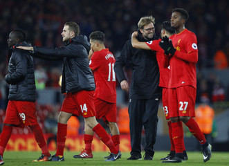 Liverpool manager Juergen Klopp and Liverpool's Emre Can celebrate after the game