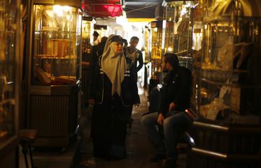 A Palestinian policewoman loyal to Hamas patrols at a jewellery market in Gaza City